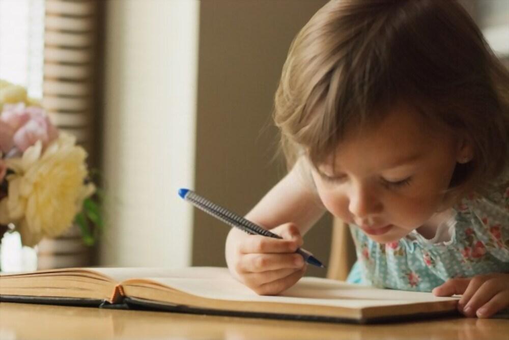 enfant écrit