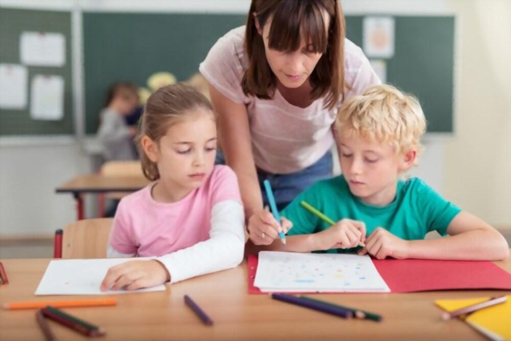 le rôle de l'école enseignant